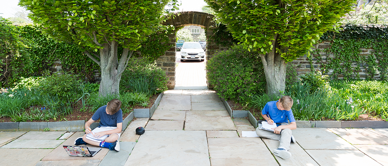 boys studying in courtyard
